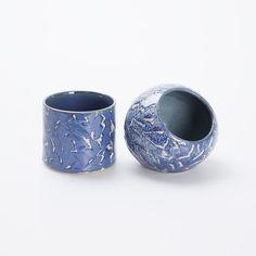 Gumu Blue Set Ceramic by Pori Keramik. Consist of 1 Pori Sink Orb Ceramic Vase Bathroom Condiments with size dimension Length: 8CM, Width: 8CM, Height: 7CMand 1 Pori Handless Mug Ceramic with size dimension Length: 8CM, Width: 8CM, Height: 7CM. Crafted from ceramic in gumu blue color and has pattern on it.  http://www.zocko.com/z/JJjUB