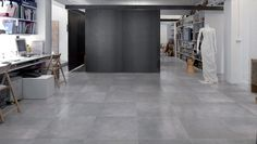 Our Graffiti Series porcelain tile in Grigio compliments this retail commercial space perfectly. | Type of tile: Porcelain coloured base tile in a cement replica | Series: Graffiti | Usage: wall and floor commercial and residential | colour: Grigio