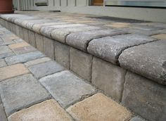 this is how to lay the thin pavers over concrete. great idea to