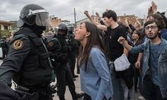 A voter in Catalonia confronts a police officer in Sant Julia de Ramis.