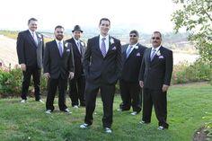 Wedding groomsmen in chucks/converse wedding. Grandfather's hankerchiefs hand-dyed DIY to match ties. Feather boutineers by https://www.etsy.com/shop/ChloeAnnDesigns?ref=shopinfo_shophome_leftnav