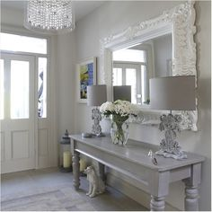 Love the huge, ornate mirror, reflects more light into the entry ~❥