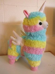 I know this isn't a accesory but it's very cute. I'll love the person who buy me this! Unicorn/Alicorn Alpaca with wings Rainbow coloured Alpaca Lama Thingy Plush Diy Unicorn, Cute Unicorn, Rainbow Unicorn, Unicorn Birthday, Unicorn Horns, Unicorn Wings, Real Unicorn, Alpacas, Cute Stuffed Animals