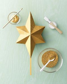 Learn how to make her glittery gold-star tree topper for your own evergreen.