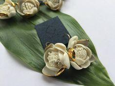 Large waterflower shaped white & golden porcelain earrings.