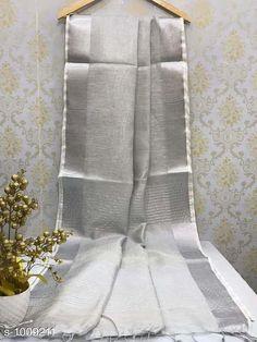 Sarees Ravishing Linen Handloom Saree  *Fabric* Saree - Linen, Blouse - Linen  *Size* Saree Length - 5.5 Mtr, Blouse Length - 0.8 Mtr  *Work* Handloom  *Sizes Available* Free Size *   Catalog Rating: ★4 (355)  Catalog Name: Rheyali Ravishing Linen Handloom Sarees CatalogID_121240 C74-SC1004 Code: 988-1009211-