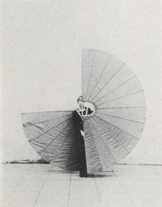 ROLU, rosenlof/lucas, ro/lu (a design & art studio's blog in minneapolis) - News > the fan suits my body -- i carry it and i balance it on my shoulders so that head and shoulders constitute the central axis of the two semi-circles -- starting position -- the two semi-circles of the fan close over my head -- when i move my body's balance