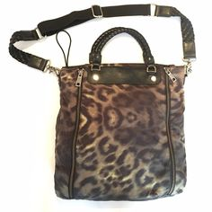 L.A.M.B.  crossbody leopard army urban chic This crossbody by LAMB is one of the chicest  most durable and practical bags you'll find. It's made of high quality materials still in great condition. Has lots of hidden pockets this bag is very roomy. Most of all the leopard print is perfect!! Please check my closet for similar items. Don't forget to like so you can be updated on any price drops. Thanks L.A.M.B. Bags Crossbody Bags