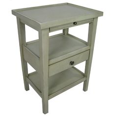 Stylist's Tip: End tables aren't just for the living room or den anymore. This sage-hue design is perfect for stowing rolled hand towels in the powder roo...