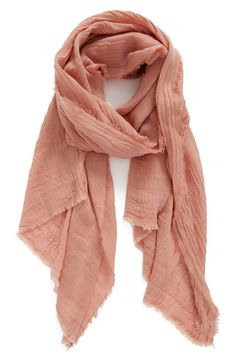 Accessorizing with this textured wool scarf from the Nordstrom Anniversary Sale! Semi-sheer and finely textured, this sweeping wrap is edged in a gentle fringe.