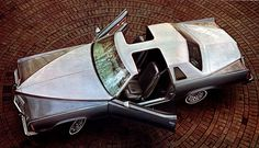 1977 Pontiac Grand Prix. Great angle!! Love the rare two-tone and t-top combo. The line would be dramatically restyled in 1978, downsized and less distinctive among the other personal luxury cars offered by GM.