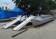 74074d1347043399-how-come-you-cant-buy-folding-trailerable-pontoon-barge-ramp1.jpg (594×420)