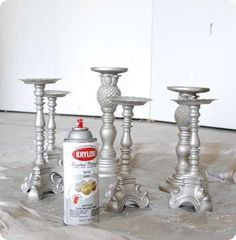 Spray Painted Thrift Store Candlesticks with Krylon's Brushed Metallic in Satin Nickel. @Jocelyn Collins