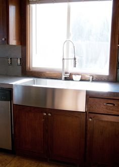 New Stainless Steel Apron Front Sink + how we installed it in existing cabinetry