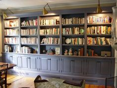 Custom bookcase painted in a steel grey color.