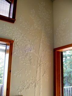 Life-sized raised plaster aspen tree stencil.