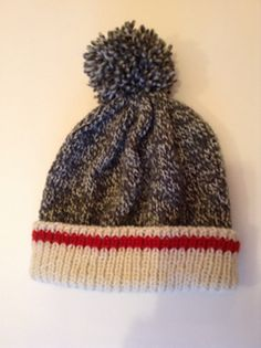 This is a classic tuque with the wool sock design worked into it. The look is very popular and adults, teens as well as children love it. It is gender neutral and makes a really nice, quick gift.