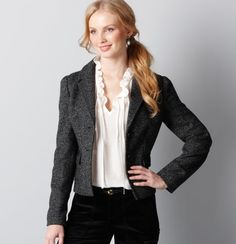 We love the tweedy texture and tailored silhouette of this modern jacket. Notch lapel. Long sleeves. Two-button closure. Flap pockets. Inverted box pleat at back hem.