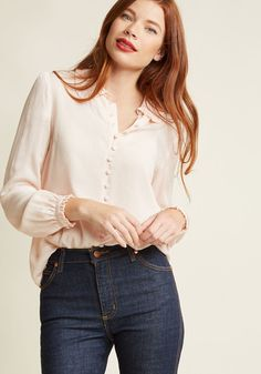 A feminine nod to the fashionable past, this delicate pink blouse makes for a blissful wearing experience! Sweetened up with a ruffled, rounded collar and...