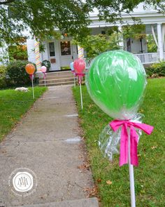 Balloons that look like hard candy and striped candy sticks for pillars made the house look like something out of Candy Land. Is there a...