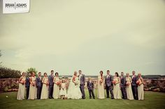 Gorgeous shot of a large wedding party taken at Bella Collina in Monteverde, Florida.  Love the coral bridesmaids bouquets.  Wedding photo by Orlando Florida wedding photographer Brian Adams PhotoGraphics www.brianadamsphoto.com