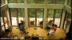 Modern cabin hangs like a treehouse over Acadian New England - YouTube