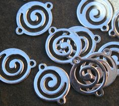 12 Swirl silver plate connectors by debsdesigns401 on Etsy