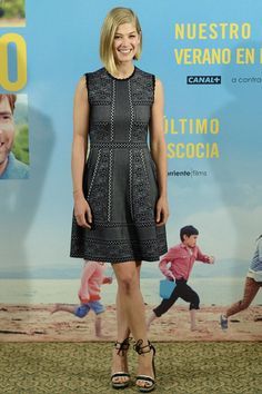Rosamund Pike wearing Alexander McQueen at a photocall for 'What We Did On Our Holiday' in Spain