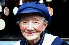 Naxi lady, Lijiang, China This old lady had a little shop on the main street of Lijiang. She says watching all the tourists file by keeps her amused. (via Naxi lady, Lijiang, China | Flickr - Photo Sharing!)