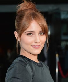 If your fringe won't pull back into your topknot, let it hang out. Dianna Agron split her bangs down the middle for a relaxed feel.