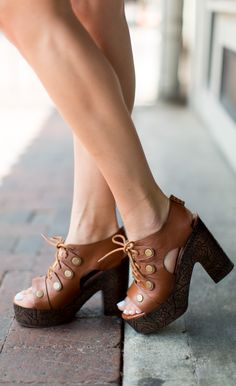 """Channel your inner 70s babe with these killer clogs. Details: - Brass studs - Lace up style - Etched wooden platform - 4 1/2"""" heel; 1 3/4"""" platform - Leather upper and lining/rubber sole."""
