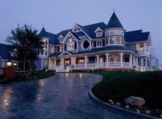 The house is too Victorian for me - but I love the long brick drive....