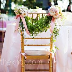 Stephanie and Trey sat at a sweetheart table with flower-embellished garland swung across the backs of their chairs. Description from theknot.com. I searched for this on bing.com/images