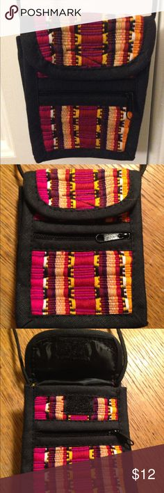 Southwestern cross-body wallet pouch Never used. Southwestern pattern of bright pink, purple and orange. Main compartment with velcro closure. One smaller front pocket with zipper. Holder ring on the back. Shoulder strap measures about 18 1/2 inches long. Bags Crossbody Bags