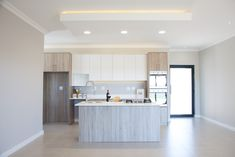 A small scale home in a quiet cul-de-sac in Langebaan Country Club, which overlooks the Langebaan Country Eco Estate with total privacy Bulkhead Ceiling, White Wood Kitchens, Kitchen Design, Space Kitchen, Large Kitchen Island, Building Contractors, Led Light Strips, Strip Lighting, Granite Countertops