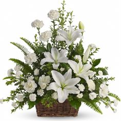 Peaceful White Lilies Basket flower arrangement - $82.95 from our Sympathy Store