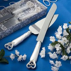Interlocking Heart Cake Knife and Server Set - The interlocking heart cake knife and server set is a beautiful addition to your wedding day. One of your essential wedding accessories, each piece has a white poly resin handle with an interlocking open heart design that is embellished with clear rhinestones. http://www.favorfavor.com/page/FF/PROD/2401