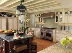 love this...but...I would have stuck with the same granite on the countertops and island