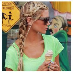 Hair braided from the forehead and caught into a large braid down the side…