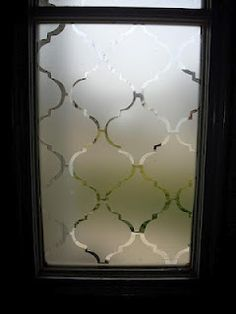 window frosting using contact paper. lets light in, gives privacy, stylish, easy to put on and take off.