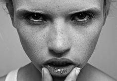 model with inside lip tattoo