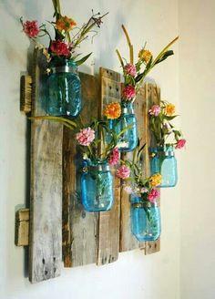 Pretty wall hanging, pallet + blue mason jars + pretty wild flowers