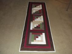 """This new bed runner/table runner is 271/2"""" wide and 83"""" long. It is a one-of-a-kind. It was handcrafted by me and machine quilted by me. The stitching is beautiful on the front. The stitches are 1/4"""" from the seam going in both directions except I did do some decorative stitches on a few seams to add dimension. 