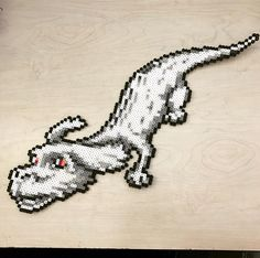 "Angela (@awesomeangela13) on Instagram: ""Falcor from The Never Ending Story perler bead. #sleepystitchshop #falcor #theneverendingstory…"""