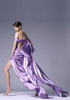 Purple in heels, stalking the scene
