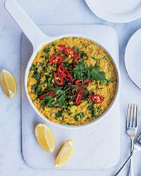 Soothing and superflavorful, this creamy red lentil dish gets a vibrant topping of spice-cooked onions, red chiles and fresh cilantro.