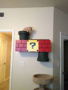 I JUST told my fiancé we should build a cat system on the wall and ceiling and to fit our gaming themed living room, we should make the cat climber Mario themed! Then I find this!