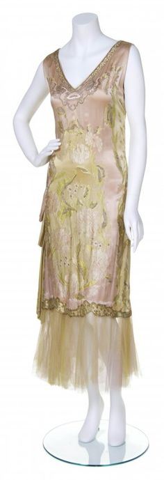 A pink and green embroidered silk dress, ca. 1923,  attributed to Callot Soeurs, Pink silk ground with foliate embroidery and pink and green tulle trim around bottom.