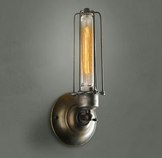 Perhaps the coolest sconce lighting I've ever seen! Restoration Hardware. Styled to look like turn of the century gas lamps but fitted with an electric bulb.