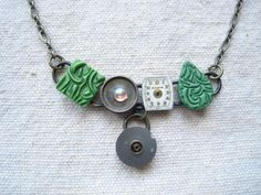 Necklace made from polymer clay and antique watch parts by Physaria
